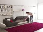 mobile trasformabile con divano avente vano contenitore