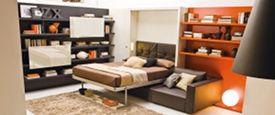 Letto trasformabile in divano con uno o due braccioli con penisola scorrevole